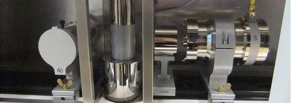 Equipment for Mössbauer spectroscopy:  drive unit with source (right), cryostat with sample inside (middle), and detector (left)